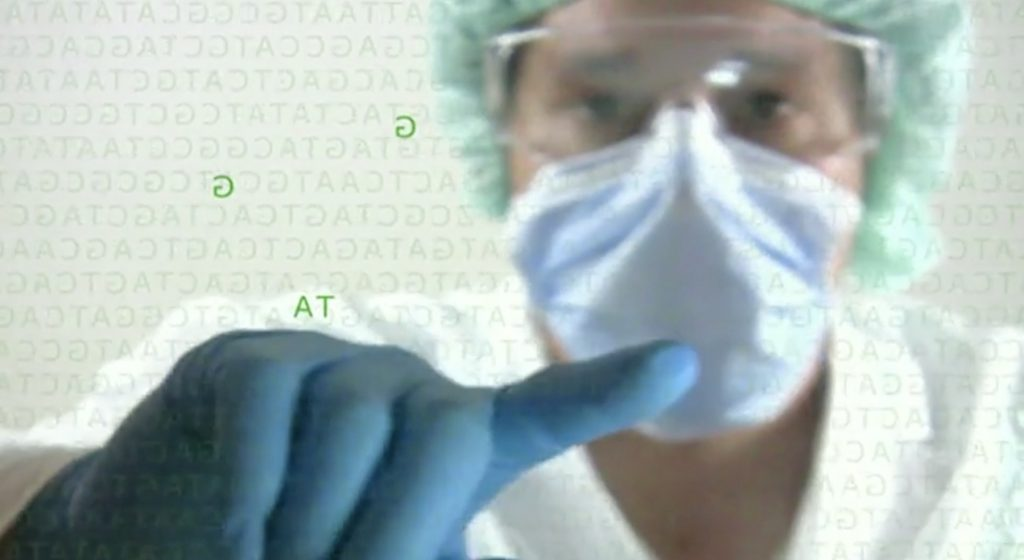 Still of a scientist wearing PPE from a pharmaceutical video production by Vismedia for GSK
