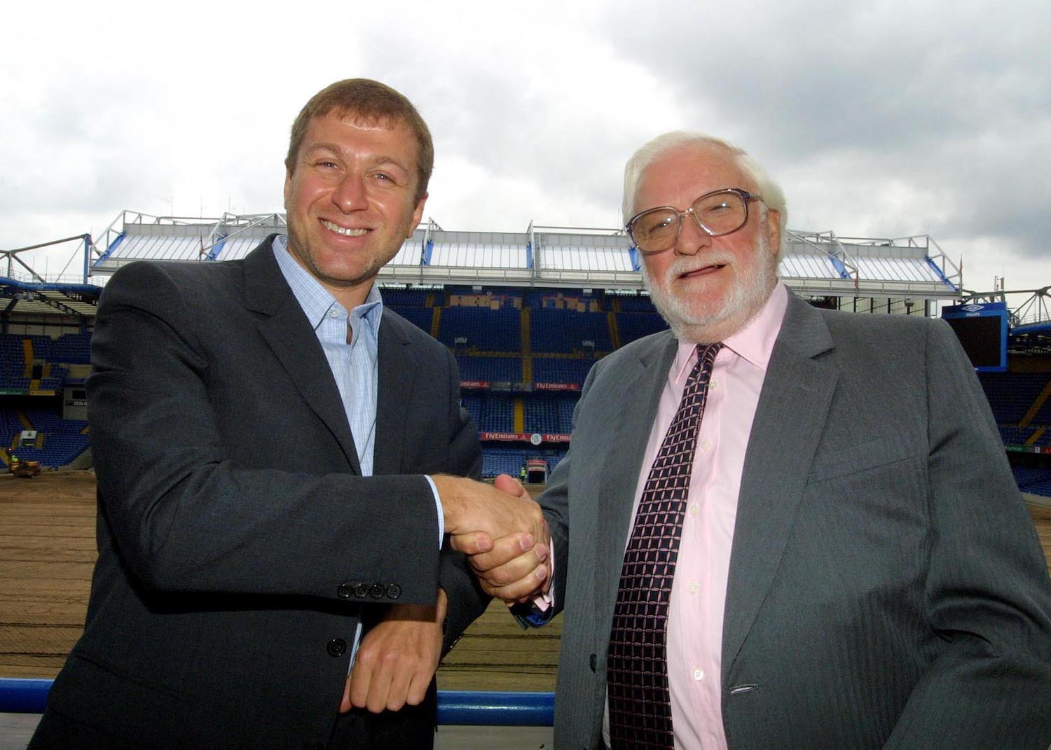 New owner of Chelsea FC Roman Abramovich shaking hands with previous owner Ken Bates in Stamford Bridge stadium